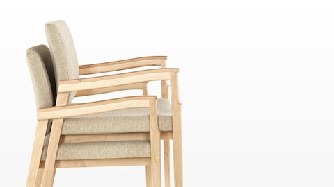 Profile view of beige Monarch chairs stacked two-high.