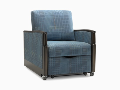 A Monarch Sleep Chair with patterned blue fabric and black arms.
