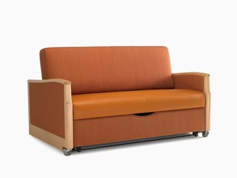 An orange Monarch Sleep Settee with wood arm caps.