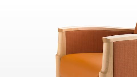 Partial view of an orange Monarch Sleep Chair with wood arm caps.