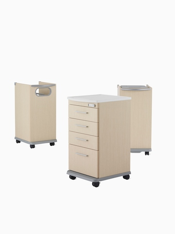 Three Mora casework carts, including a supply cart, linen cart, and trash cart in a light ash finish.