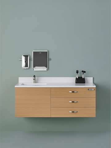 Wall-mounted Mora System casework consisting of three drawers and an integral sink and backsplash.