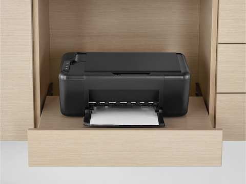 A printer sits on a pull-out printer tray, part of the Mora clinical casework system.