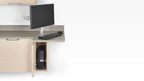 Technology support available with the Mora clinical casework system, including a CPU cabinet and monitor arm.