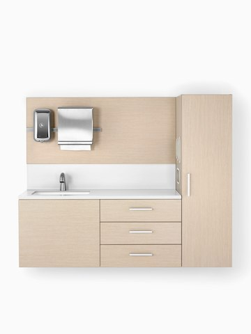 Mora System casework in an ash finish with a white solid surface and integrated sink.