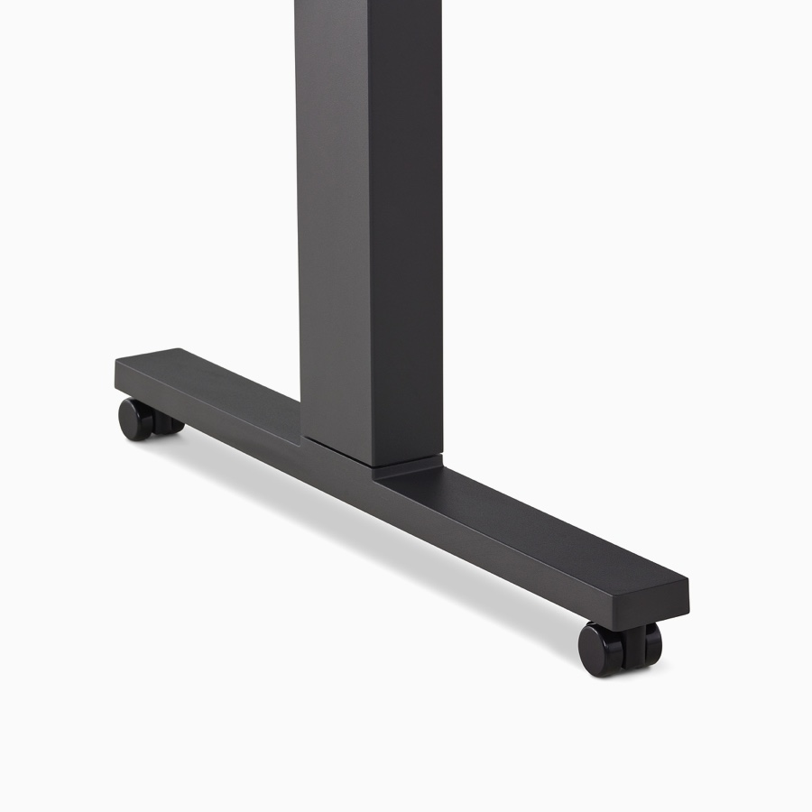 Close-up of a black Motia Sit-To-Stand Table leg with black casters.