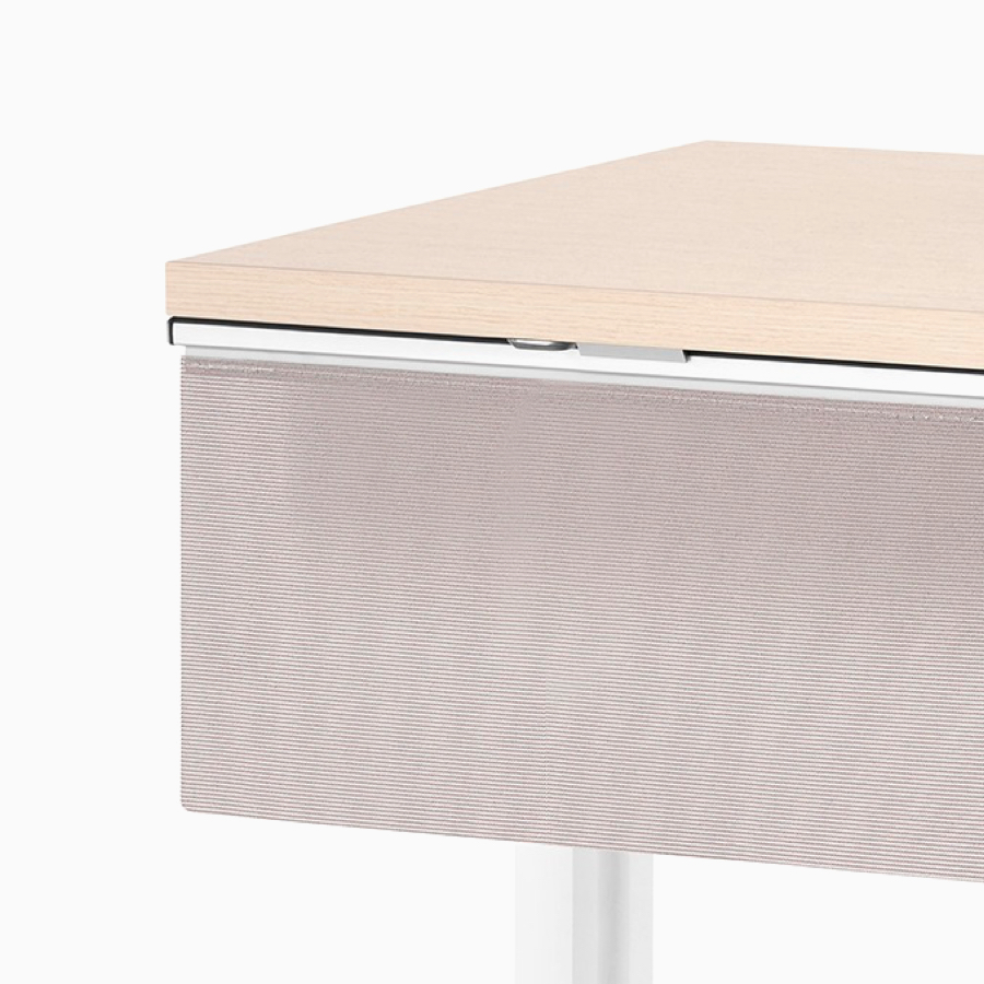 Close-up of a tan laminate privacy screen installed on a Motia Sit-to-Stand Table that has a white top and silver legs.