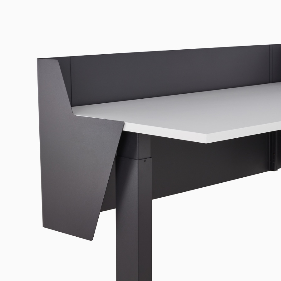 Close-up of a wrapped black metal privacy screen attached to a Motia Sit-To-Stand Table.
