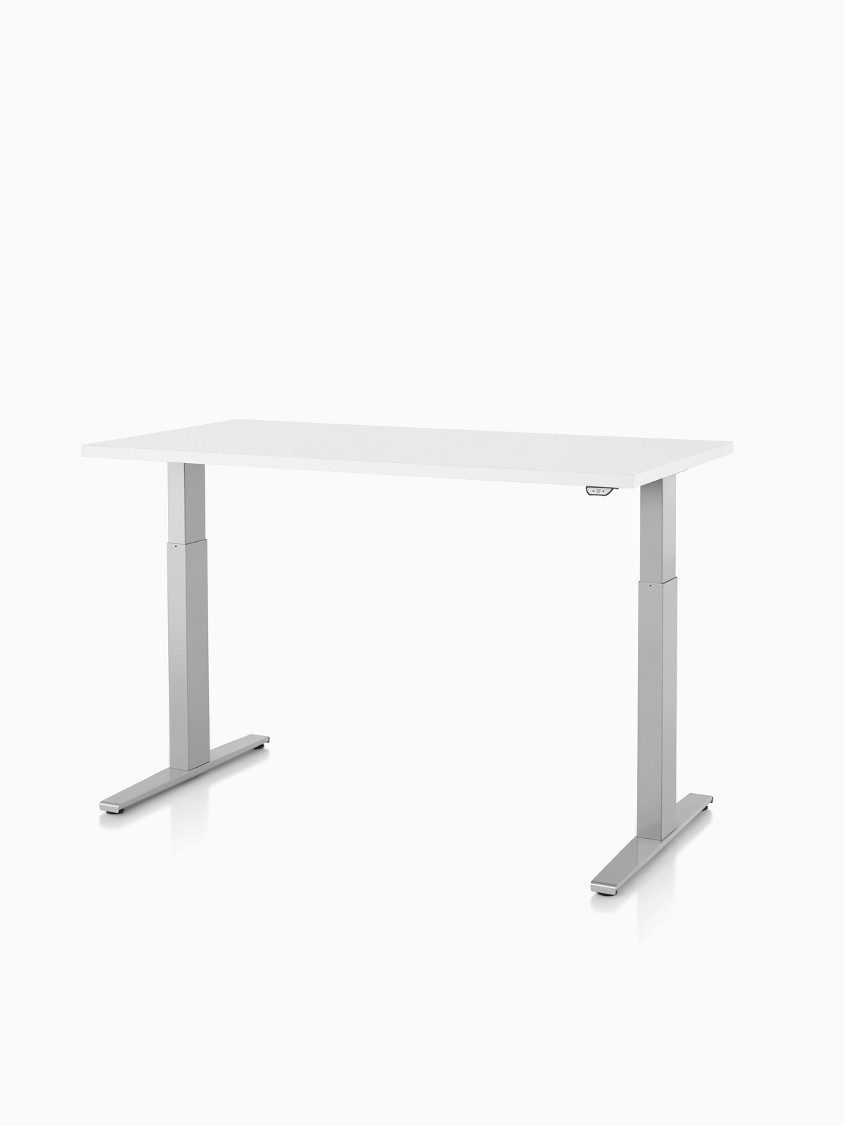A Motia Sit-to-Stand Table with a white top.