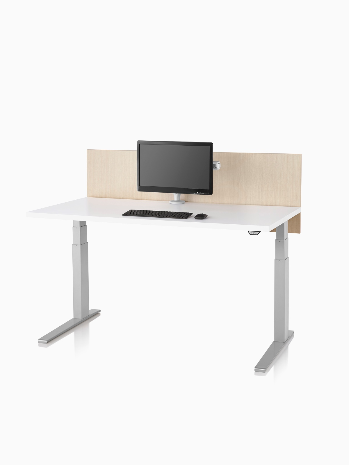 A tan laminate privacy screen installed on a Motia Sit-to-Stand Table that has a white top and silver legs.