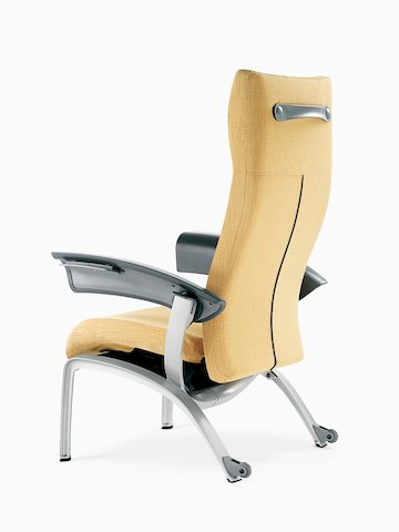 A mustard-coloured Nala Patient Chair, viewed from a three-quarter rear angle.