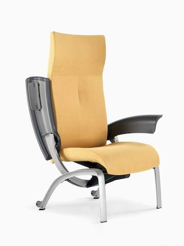 Angled view of a mustard-coloured Nala Patient Chair with one arm pivoted back for easier patient access.