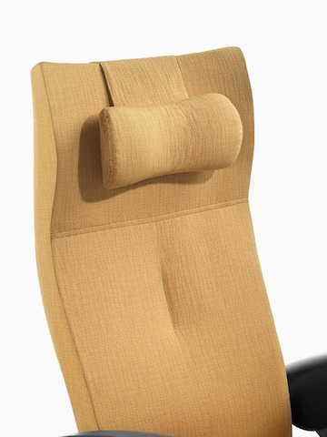 Close view of the upholstered headrest on the back of a mustard-coloured Nala Patient Chair.