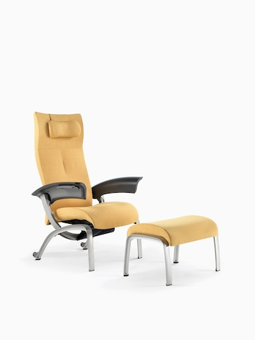 A mustard-coloured Nala Patient Chair and ottoman.