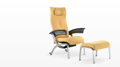 A mustard-coloured Nala Patient Chair and ottoman, viewed from a 45-degree angle.