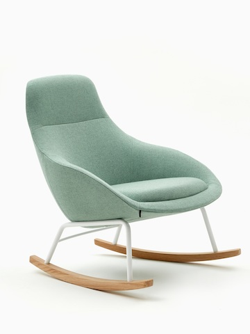 An angled view of a naughtone Always Lounge Chair with light green upholstery, fitted with a rocking chair base in white steel and hardwood.