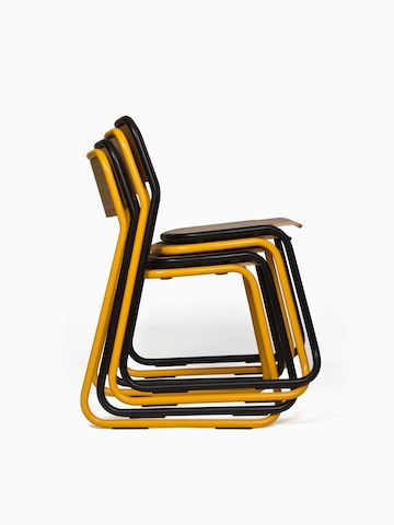 A stack of four naughtone Bounce Chairs viewed from the side, alternating yellow and black.