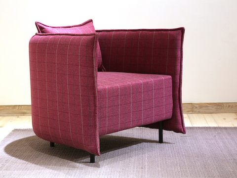 A naughtone Cloud Plain Armchair upholstered in a refined burgundy plaid, positioned at an angle on an area rug.