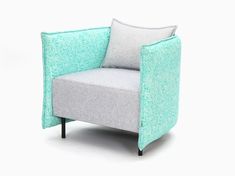 Angled view of a naughtone Cloud Plain Armchair with intricately patterned fabric in two colors: a teal surround and a gray seat and seatback.