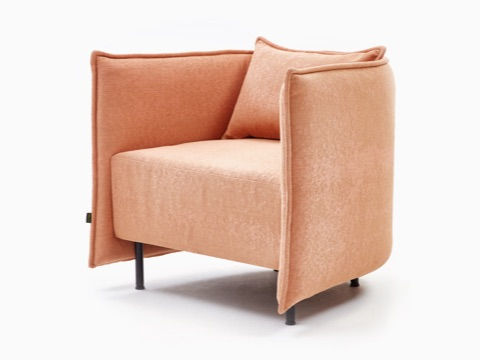 Angled view of a naughtone Cloud Plain Armchair upholstered in peach-colored fabric.