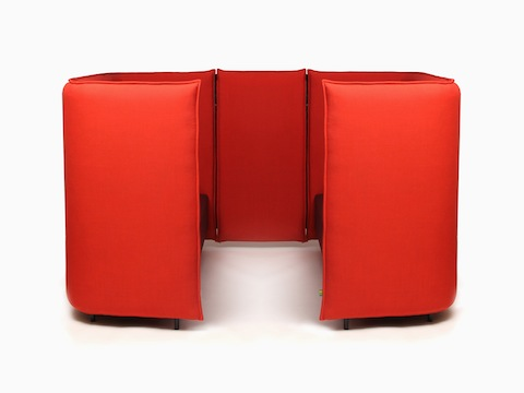 A naughtone Cloud Plain Booth upholstered in bright red, viewed from the side.