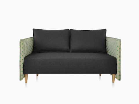 Cloud Plain Low Back Two-Seat Sofa with a dark grey textile, Maharam avocado dot textile, and solid wood legs.