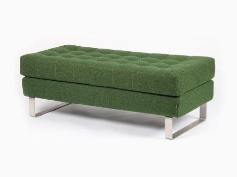 A green naughtone Clyde Bench with a steel sled base, viewed at an angle.