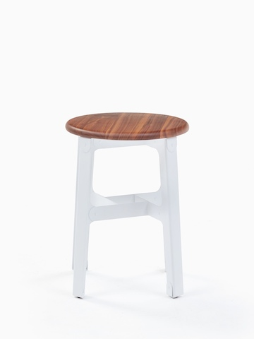 A low white naughtone Construct Stool.