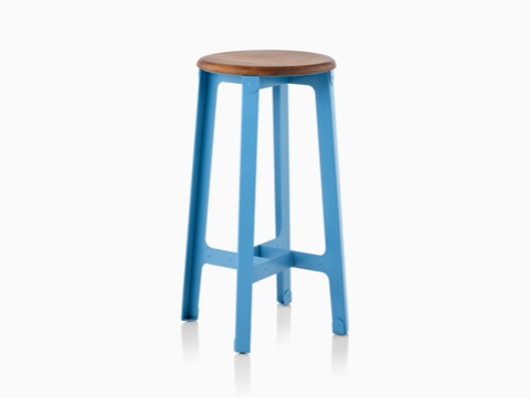 Construct Barstool with a wood lacquered seat and a blue hard-wearing polyester powdered steel base, viewed at an angle.