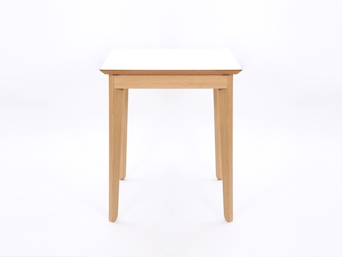 A square white naughtone Dalby Café Table, viewed from the side.