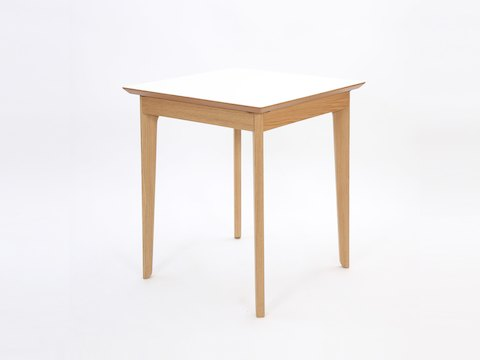 A square white naughtone Dalby Café Table, viewed at an angle.