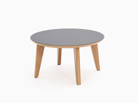 A round dark gray Dalby Coffee Table, viewed at an angle.