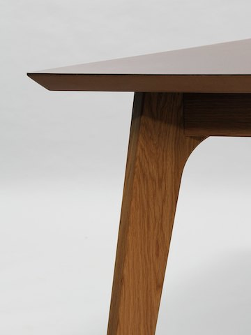 A close-up detail view of the polished MDF edge and reverse chamfer of a naughtone Dalby Conference Table.