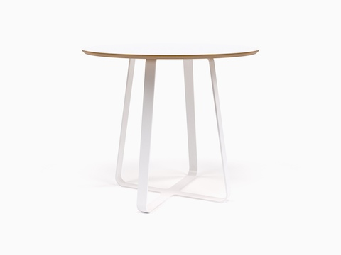 An all white round naughtone Frog Café Table, viewed at an angle.