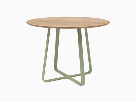 A round oak topped naughtone Frog Café Table with a light green base, viewed at an angle.