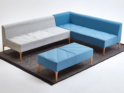 A gray and blue naughtone Hatch Modular Seating units and a blue Hatch Bench placed over a single rug.