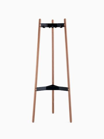 A front view of a Hudson Coat Stand with walnut dowel legs and black metal supports.