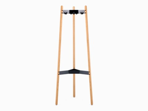 A front view of the Hudson Coat Stand with oak dowel legs with black metal supports.