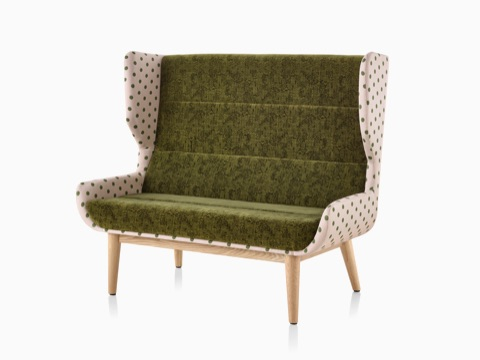 Hush Sofa with a Maharam Paul Smith Lychee Dots outer textile, a dark green inner textile, and a wood base.