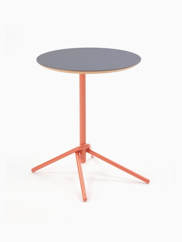 A naughtone circular Knot Side Table with a gray top and orange base, viewed at an angle.