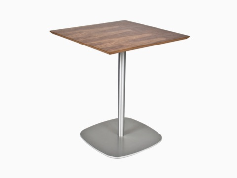 A square walnut-topped Ped Café Table with a stainless-steel base, viewed at an angle.