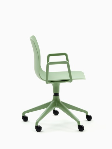A pale green naughtone Polly Chair with a 5-star base, viewed from the side.