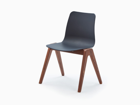 A black naughtone Polly Wood Chair with walnut armrests and base, viewed at an angle.