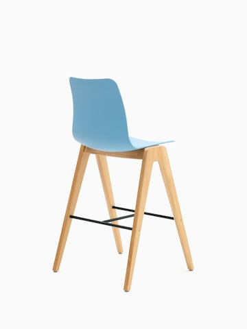 A light blue naughtone Polly Wood Stool with an oak base, viewed from the back at an angle.
