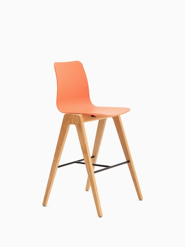 An orange naughtone Polly Wood Stool with an oak base, viewed at an angle.