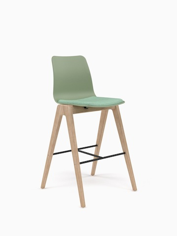 A green naughtone Polly Wood Stool with a green seat pad and oak base, viewed at an angle.