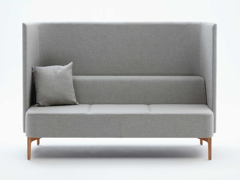 Three-seat high-back Pullman Sofa, upholstered in pale grey fabric with cushion and oak legs, viewed from the front.
