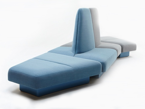 A naughtone Rhyme Modular Seating unit made of blue and gray pieces, viewed at an angle.