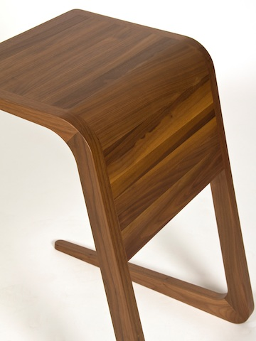 A close-up, overhead view of a Riley Table in walnut.