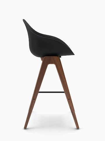 Side view of black Ruby Wood Stool on walnut barstool base.